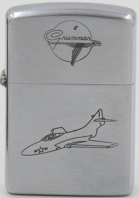 """1953 Zippo with a Grumman logo on the lid, an F9F """"Cougar"""" aircraft on the case."""