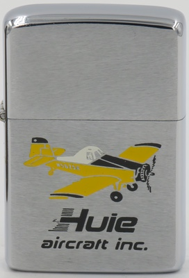 Graphic of a plane on a 1975 Zippo. Huie Air.craft Inc. is no longer in existence