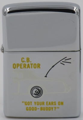 """1976 Zippo depicting the back end of an automobile with an antenna. C.B., or Citizen Band radio, a system of short distance radio communications that is shared by many users. C.B. radio is used primarily by truck drivers . """"Good Buddy"""" is a term used among truckers and others as a salutation when the other operator's handle is unknown"""