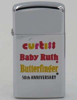 """1973 slim Zippo commemorating the 50th Anniversary of the Curtiss Candy Company. The """"Baby Ruth"""" candy bar not named after Babe Ruth, the home run king, but supposedly after President Cleveland's daughter """"baby"""" Ruth. The """"Butterfinger"""" candy bar was introduced in 1928"""