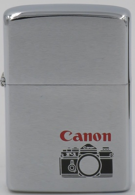 1981 Zippo with a Canon camera. The origins of Canon date back to the founding of Precision Optical Instruments Laboratory in Japan in 1937. Between 1933 and 1936 'The Kwanon', a copy of the Leica design, Japan's first 35 mm focal-plane-shutter camera, was developed in prototype form