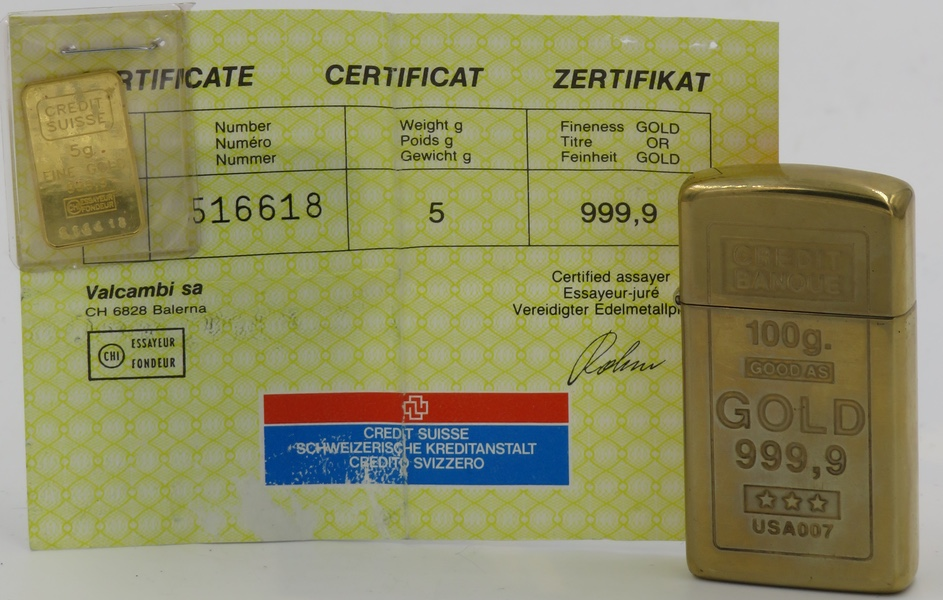 1998 gold-plated slim Zippo advertising Credit Suisse Bank. The lighter is accompanied by a 5 gram ingot of 999.9 pure gold