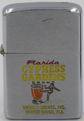 A glass of orange juice and a waterskiing southern belle is engraved on this 1958 Zippo for Cypress Gardens,  amusement park in Winter Haven, Florida  and Snively Groves Inc., one of Florida's largest citrus growers