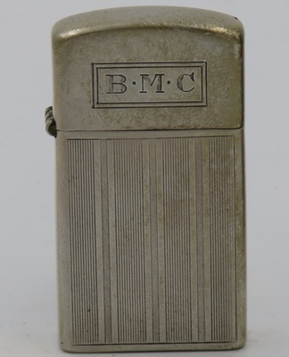 Rare slim  1955-58 Sterling Zippo with a vertical lines design bottom and plain lid with initials BMC