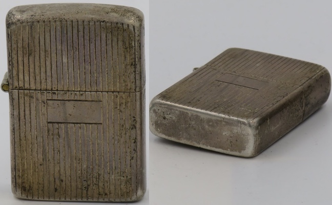 1940's prototype Sterling Zippo with engine-turned vertical lines.  The lighter has a flat unmarked bottom which is rare