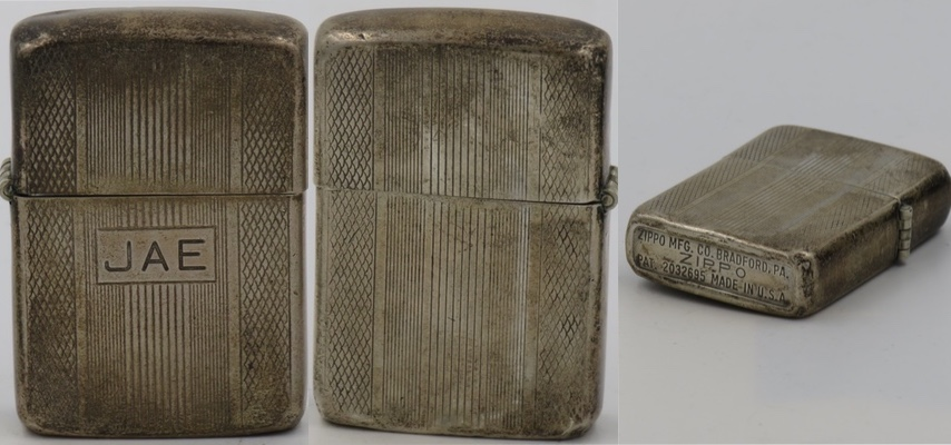 "Rare 1949-50 Sterling Zippo with canned bottom and 5-barrel hinge.  The toned case has vertical lines and is inscribed with the initials ""JAE"""