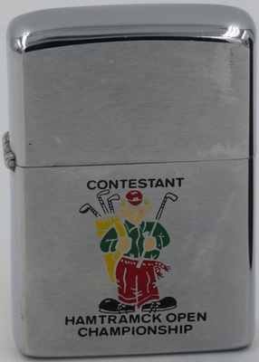 "1972 Zippo displaying golfer carrying his golf clubs and holding his nine iron and is inscribed, ""CONTESTANT HAMTRAMCK OPEN CHAMPIONSHIP"". The Hamtramck Michigan golf tournament is no longer held"