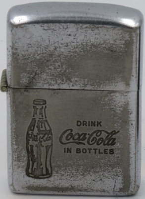 """1953 Zippo with image of a bottle and """"Drink Coca-Cola in Bottles"""