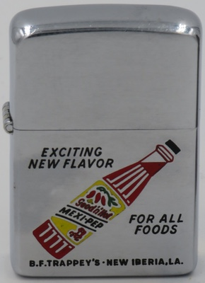 """1959 Zippo with a graphic of a """"Good 'n hot"""" Mexi-Pep salsa bottle - """"Exciting New Flavor for All Foods"""". Founded in 1898,Trappey's Hot Sauce is one of the oldest hot sauce brands in the United States originally produced in New Iberia,Louisiana"""
