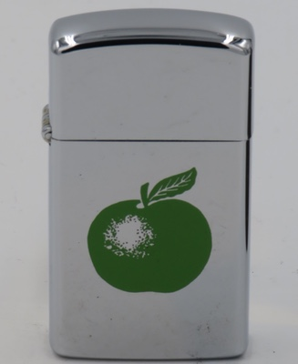 Rare 1971 slim Zippo the the graphic of the Granny Smith apple that has served as the logo for the Beatles' record label.  The logo is now the property of the Apple computer company.