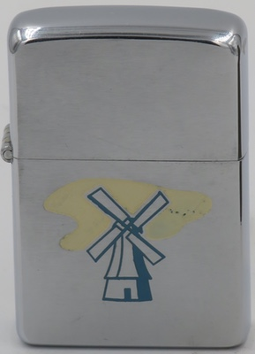 1955 Zippo with a windmill, possibly related to Van de Kamp Dutch Bakeries