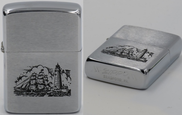 1986 Zippo with a graphic of a sailing ship near a lighthouse. What is unusual is that the bottom is flat rather than canned as is standard for Zippo lighters