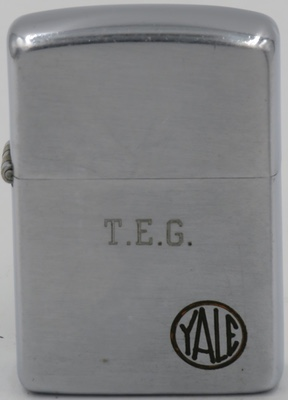 "11953 Zippo with a Yale logo and the initials ""TEG"" engraved on the lid. Yale is a lock manufacturer associated with the pin tumbler lock, which is often known as the Yale lock. The business was founded in Stamford, Connecticut, in 1868 by Linus Yale, Jr., the inventor of the pin tumbler lock."