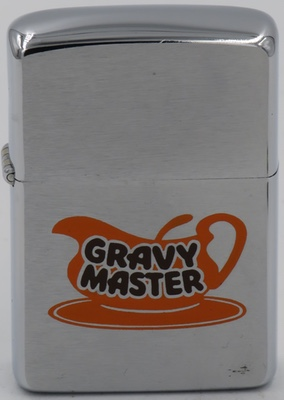 1962 Zippo with image of a gravy boat advertising GravyMaster. Introduced in 1935, made of ingredients ranging from pure cane sugar to herbs and spices, GravyMaster has become a staple in the home cook's kitchen.