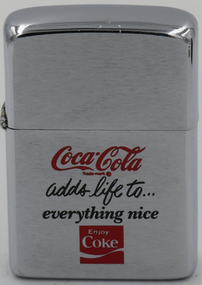"""1981 Zippo with the """"Coca-Cola adds life to everything nice"""" slogan and the Coca-Cola logo"""