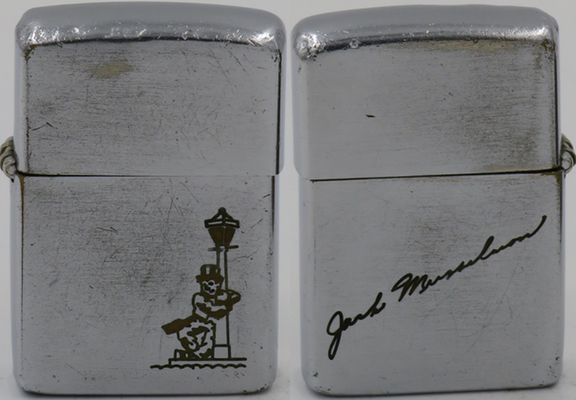 The design of the Drunkard or Reveler leaning against a lamp post seen on the this rare 1949-50 Zippo was one of the very first images made on the early Metallique Zippos of the mid-1930's, making it a highly desirable design among Zippo fans. This one belonged to Jack Musselman