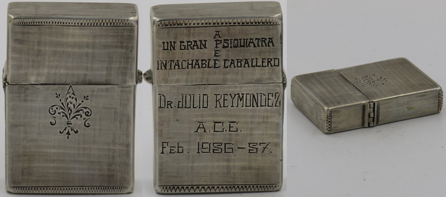 "Cuban engraving on Sterling silver lighter with engraving of fleur-de-lis on one side. 'Un Gran Psiquiatra e Intachable Caballero"" (A great psychiatrist and flawless gentleman) - Dr. Julio Reymondez A.C.E. Feb. 1956-57"" on the reverse"