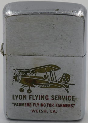 "1964 Zippo with bi-plane advertising Lyon Flying Service in Welch, LA.  ""Farmers Flying for Farmers"""