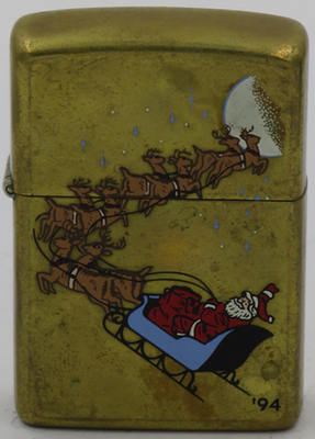 1994 proto Santa re1994 prototype brass Zippo of Santa with his flying reindeer pulling his sleigh into the skyindeer brass.JPG