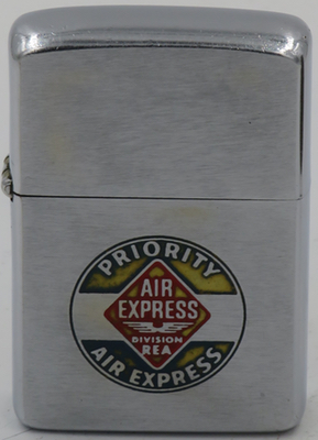 1963 Zippo advertising Priority Air Express, a division of REA, the  Railway Express Agencywhich was a national monopoly set up by the United States federal government