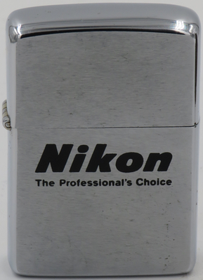 """1976 Zippo for Nikon""""The Professional's Choice"""". The Nikon Corporation founded in 1917 as Nippon Kogaku K.K. which became a leading manufacturer of optical lenses and photographic equipment"""