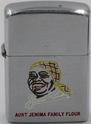 1953 Zippo advertising Aunt Jemima Family Flour. Aunt Jemima, a former slave named Nancy Green, was the world's first living trademark and her interesting story is  HERE .