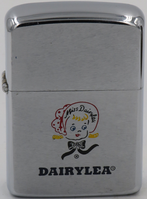 """1967 Zippo with a graphic of Miss Dairylea.The iconic """"Miss Dairylea"""" was introduced in the 1920s to help promote Dairylea products. She adorned promotional materials the dairy brand until she was retired in the 1970's"""