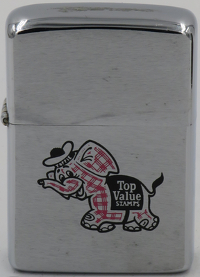 1974 Zippo with the pink plaid Toppie, The Top Value Elephant. Top Value Stamps, like the S&H Green stamps, were given away by retailers to customers who would paste them into special books which could then be redeemed for merchandise