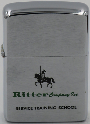 This 1963 Zippo with a knight on his horse for Ritter Company Inc. - Service Training School. Not shown reverse has the signature of Michael Brady