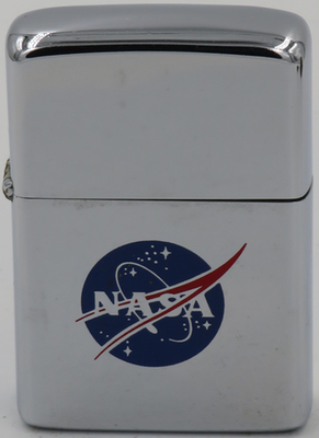 """1972 Zippo with the NASA """"meatball"""" design. The sphere represents a planet, the stars represent space, the red chevron is a wing representing aeronautics,and then there is an orbiting spacecraft going around the wing."""