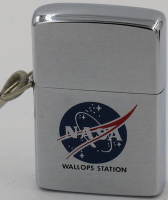 1963 loss-proof Zippo with the NASA logo.Wallops Station is located on the Eastern Shore of Virginia primarily as a rocket launch site to support science and exploration missions for NASA and other Federal agencies.