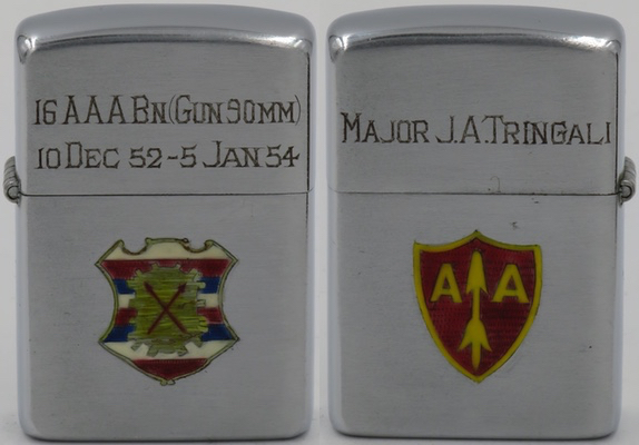 """1953 Zippo for the with engraved emblems for the Army's 16th Antiaircraft Artillery Battalion. The front of the lid reads """"16 AAA Bn. (Gun 90MM) 10 Dec 1952 - 5 Jan 1954"""", referring to the 90mm antiaircraft gun used by the battalion. The lid reads """"Major J.A. Tringali on the reverse"""