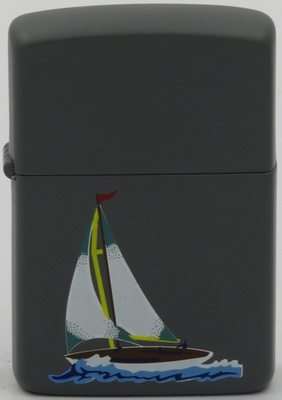 1986 Zippo with a prototype design of a sloop on gray