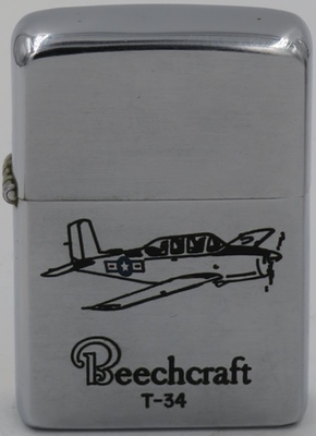 The Beechcraft T-34 was the military designation for the Model 45. Here it appears in a line-drawn engraving on a 1955-56 Zippo