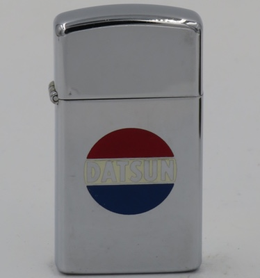 """1980 slim Datsun Zippo. Datsun, produced by Nissan Motor Company traces its origins back to 1911. The name comes from the """"Son of DAT"""" after the Japanese """"Datto"""", or running hare"""