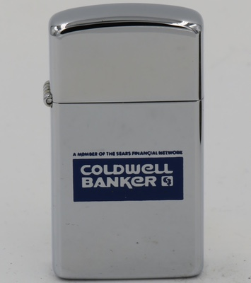 """1984 slim Zippo for """"Coldwell Banker - A member of Sears Financial Network"""" The roots of Coldwell Banker date back to 1906 when Colbert Coldwell, later joined by Benjamin Arthur Banker, established a company committed to commercial real estate to become the dominant commercial real estate company across America. Coldwell Banker was acquired by Sears in 1981 and sold it to CB Richard Ellis in 1989"""