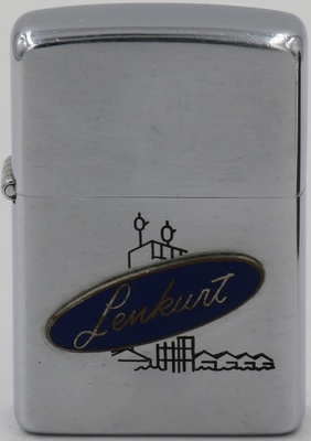 "1956 Zippo with an attached badge for ""Lenkurt"" over a line drawn engraving of a building. Lenkurt, a manufacturer of telephone carrier equipment, was acquired by GTE in 1959"