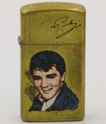 1987 slim Zippos with face of young Elvis on a slim brass case.