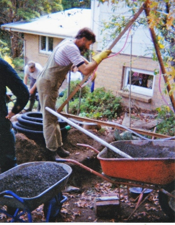 Installing grey water absorption trench around 1995