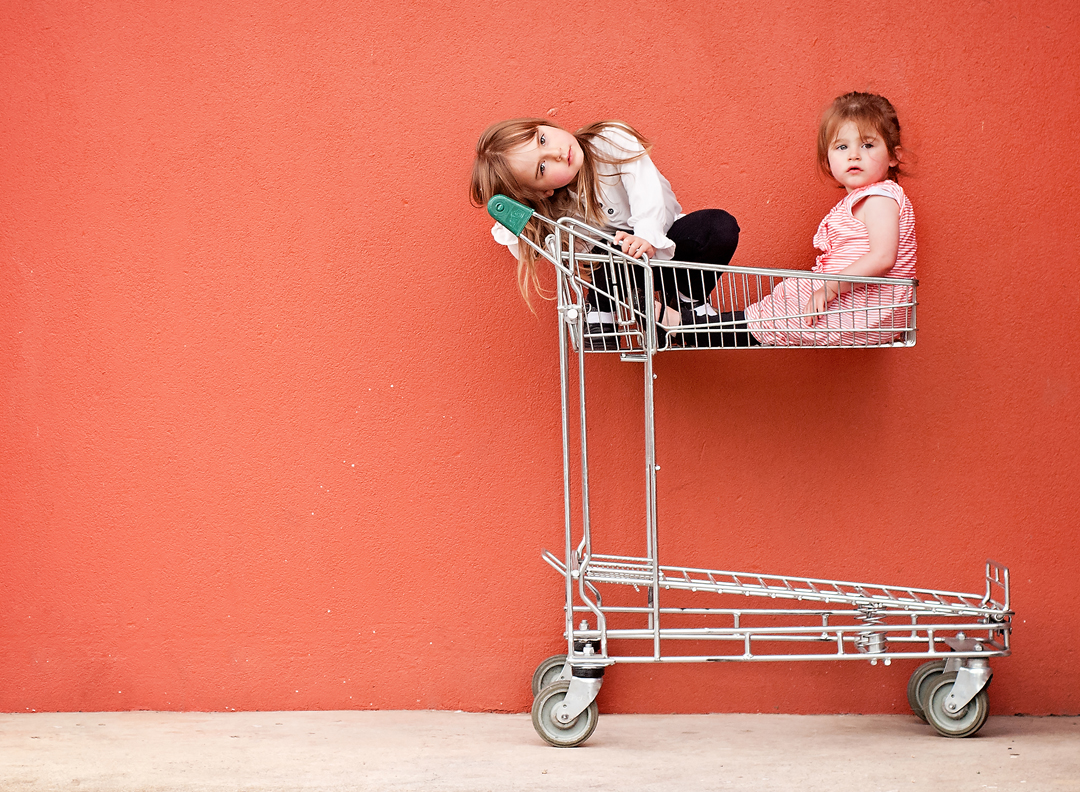 family lifestyle photography melbourne children in shopping trolley.jpg