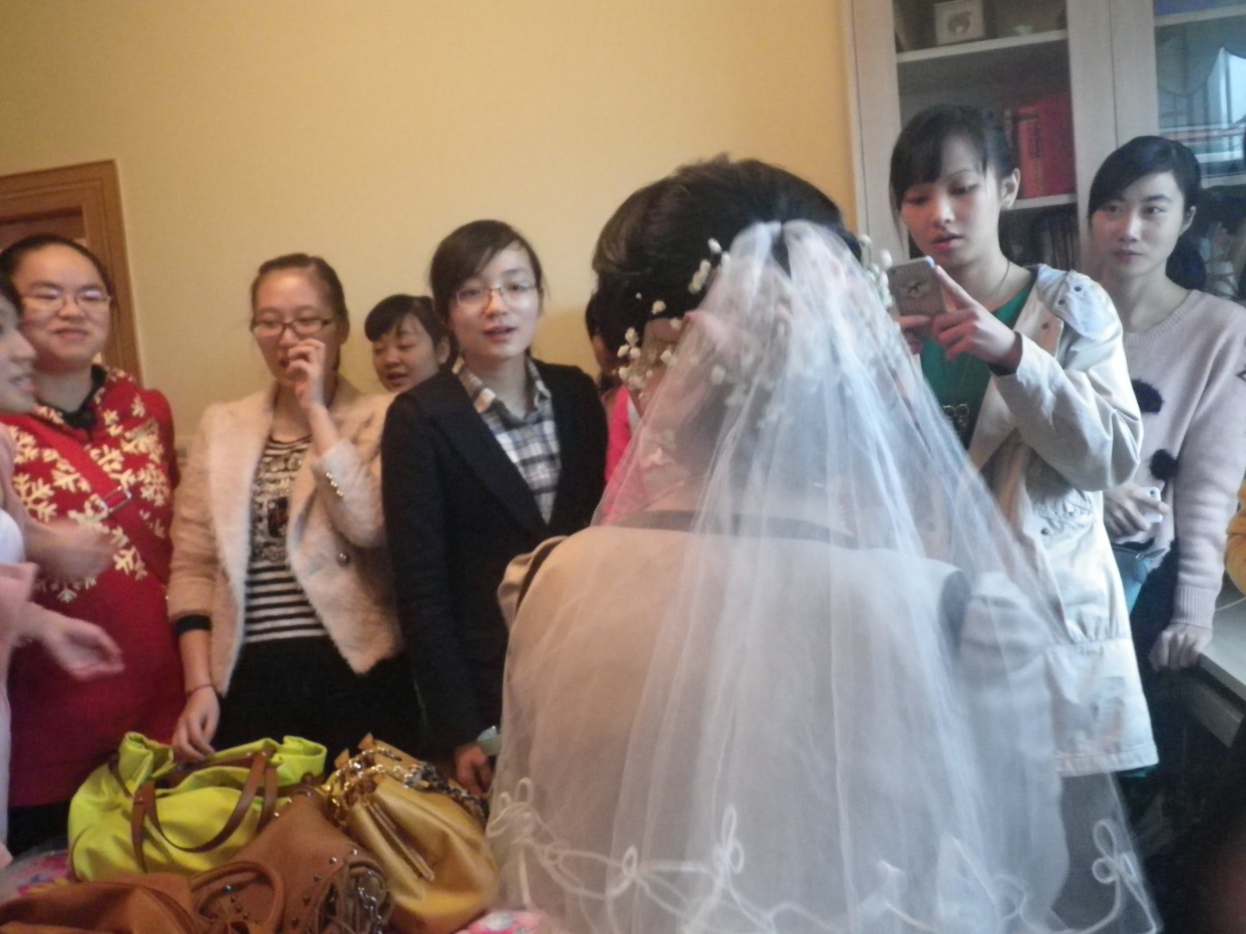 At a friend's wedding in China. It was before the ceremony, and it's tradition for all the unmarried women to wait with the bride in her room before the groom gets there. So this is of all the unmarried women at the wedding and the bride.