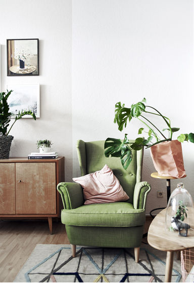 Green Ikea chair and rug living room