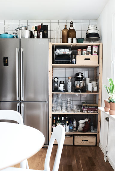 Organised Ikea shelves in kitchen