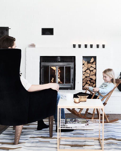 Log fire and Ikea chair in living room