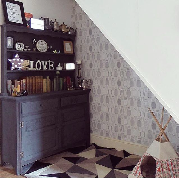 Owl wallpaper under the stairs