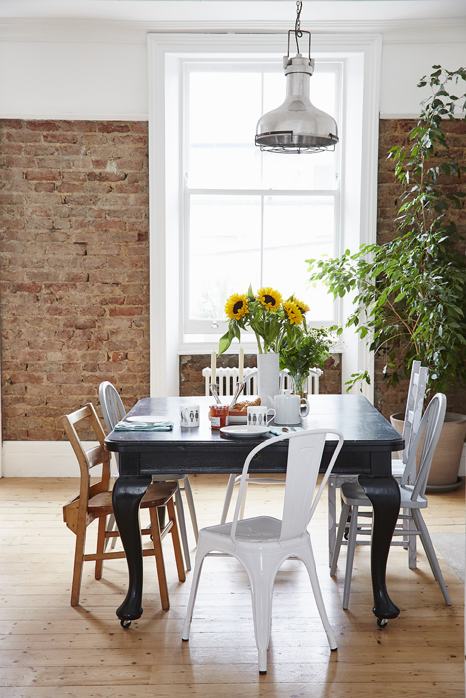 An old dining table and mismatched chairs