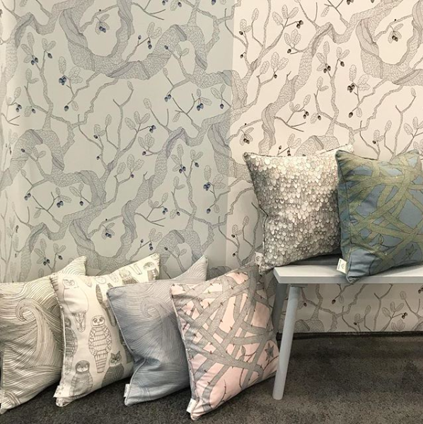 Cushion covers and Oak tree wallpaper at ICFF