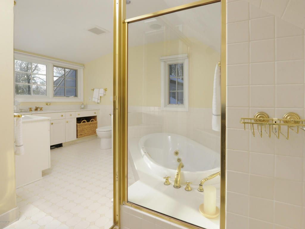 Fickle fashion: gold fixtures were all the rage in the 80s. Now, not so much. Wait'll you see the avocado refrigerator!