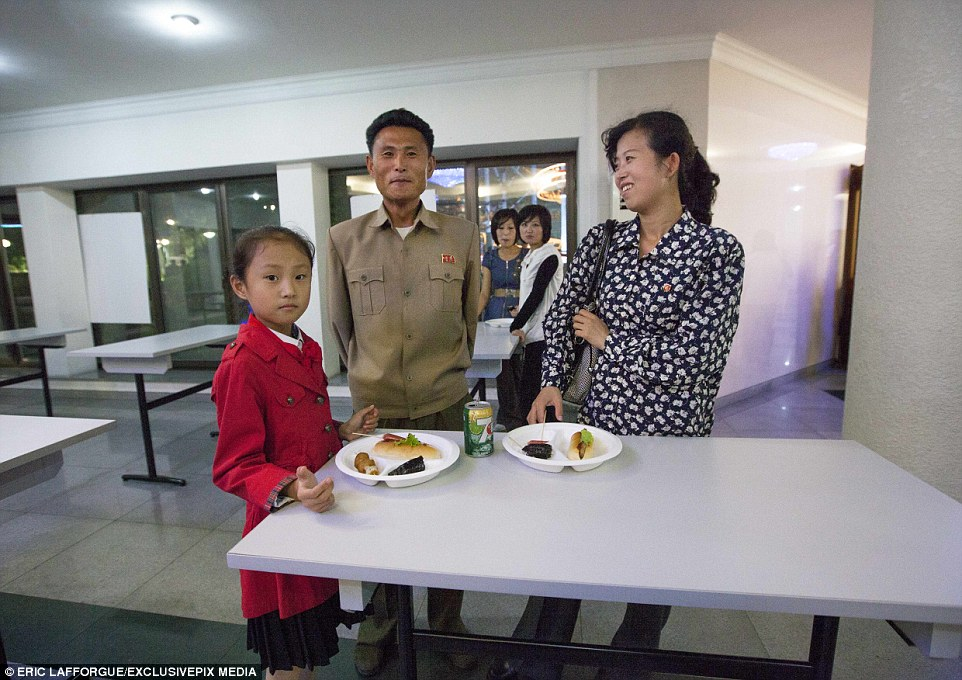 North korean family shares two servings of sawdust and a can of COUNTERFEIT 7-Up in an ABANDONED people's restaurant.