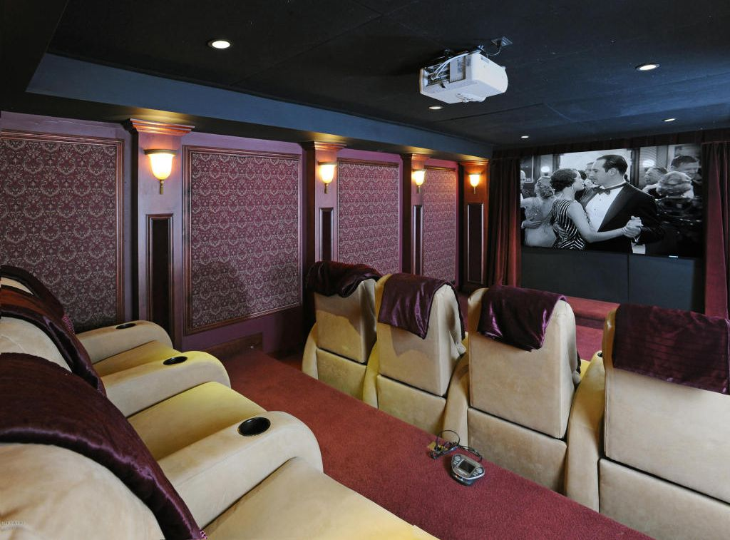 Not just dated, obsolete. Home theatres have gone the way of mid-60s slide shows of your friends'latest vacation, or super 8 movies of their kid's performance in her school play. admittedly, there's not much else to put in a windowless basement, but they're no selling point.